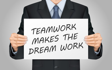close-up look at businessman holding teamwork makes the dream work poster