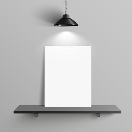 elegant blank canvas with illumination placed on shelf over grey wall