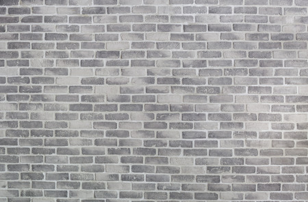 Old grey brick wall for background or texture