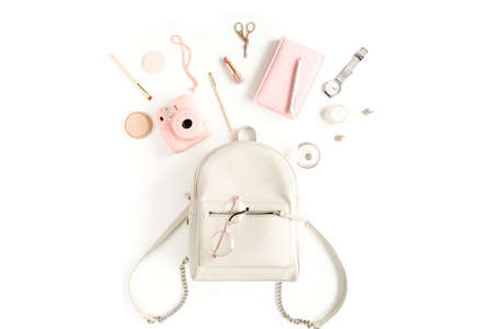 Photo for Womens beige backpack with fashion accessories on white background top view. Flat lay female style look. Top view. - Royalty Free Image