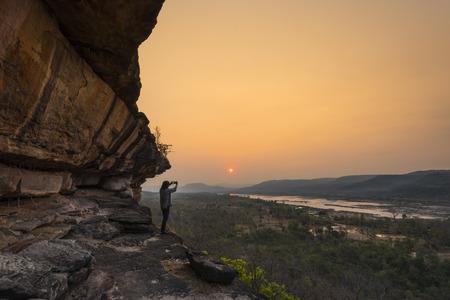 Men are shooting photo at sunrise, Pha Taem National Park, Ubon Ratchathani, Thailand