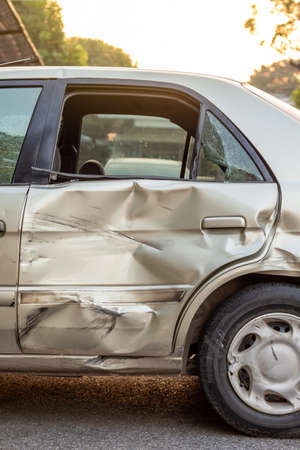 Photo pour Close-up of a side door of a golden Bond car that was demolished in a collision accident with another vehicle. - image libre de droit