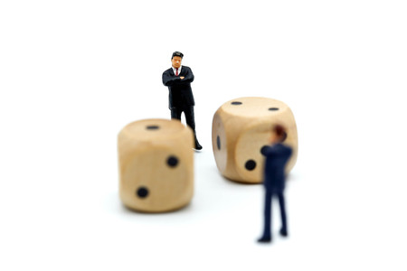 Miniature people : competition of businessman with wooden dices,business Challenge and strategy concept.