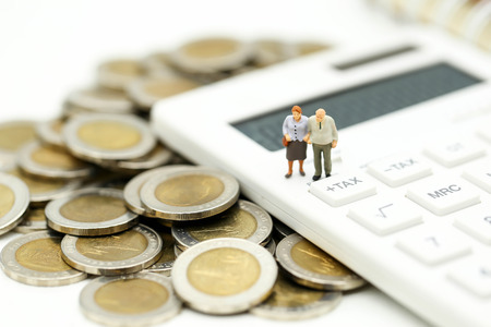 Photo for Miniature people : Couple oldman standing with Calculator,business,tax concept. - Royalty Free Image