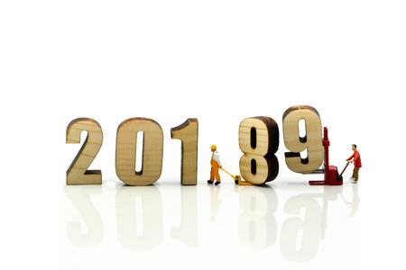 Foto de Miniature people : Worker with wooden of number 2019,Happy New Year 2019 concept. - Imagen libre de derechos