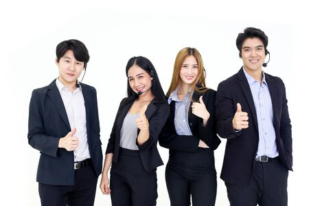 Foto de Asia Group of call center workers or Confident business team with headset standing on white - Imagen libre de derechos