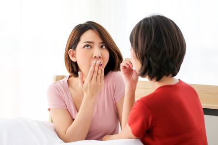 Photo pour Happy Couple  asia woman  bored with bad breath in bedroom morning. - image libre de droit