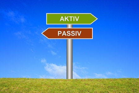 Signpost showing directions - Active or passive in german language