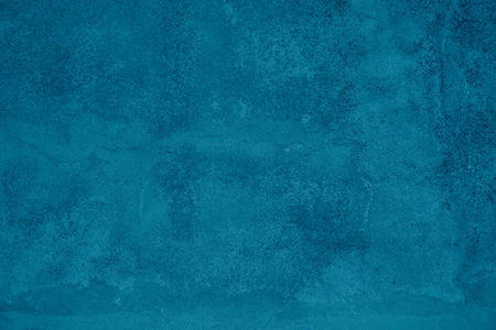Cool grunge background of an old turquoise surface