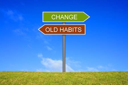 Foto de Signpost outside is showing Old habits and Change - Imagen libre de derechos