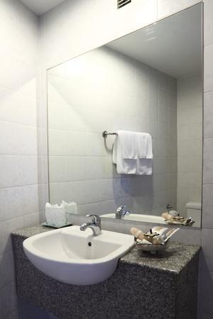 Bathroom water sink on marble base.