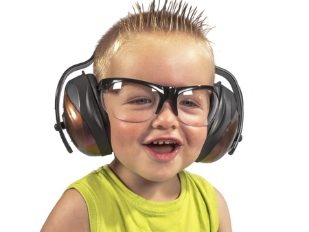 toddler sitting with headphones on his head on a white background