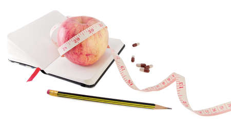 Diary with fruit and biologically active supplement in pills for efficient dieting