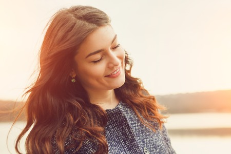Photo pour Shallow DOF. Selective focus on left eye. Closeup portrait of a gorgeous elegant dreamy brunette young woman daydreaming outdoors with eyes closed - image libre de droit