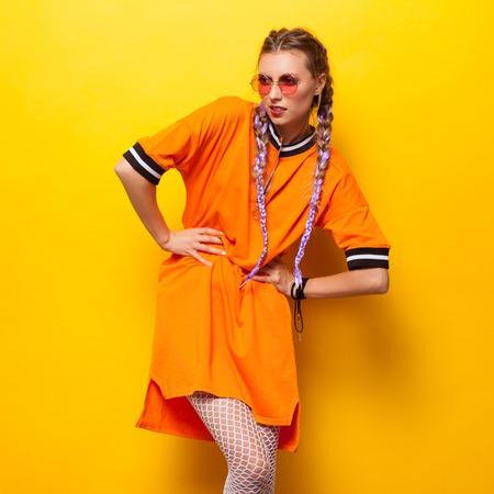 Photo pour Fashionable woman posing in studio - image libre de droit