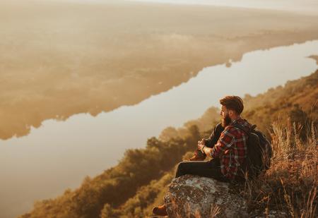 Pensive backpacker enjoying views