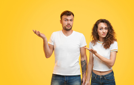 Photo for Doubtful couple pointing away - Royalty Free Image