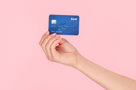 Photo for Woman showing card of bank - Royalty Free Image
