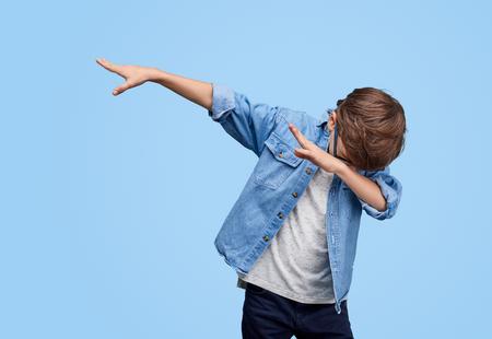 Photo pour Stylish kid performing dab dancing - image libre de droit