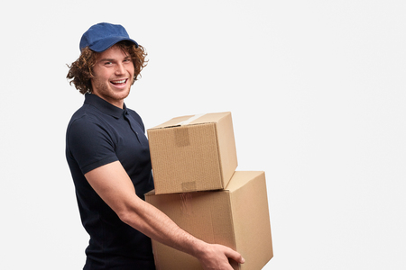 Photo pour Cheerful courier of free shipping service - image libre de droit