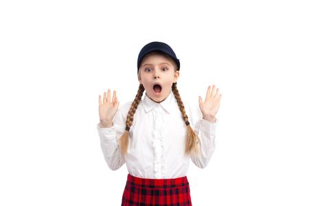 Photo pour Shocked schoolgirl looking at camera - image libre de droit