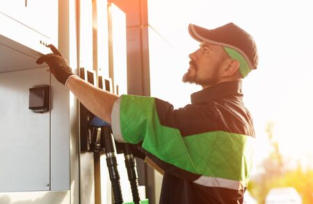 Photo for Man working on gas station - Royalty Free Image