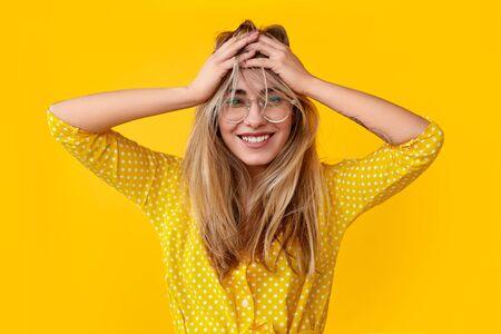 Photo pour Excited young woman rumpling hair - image libre de droit