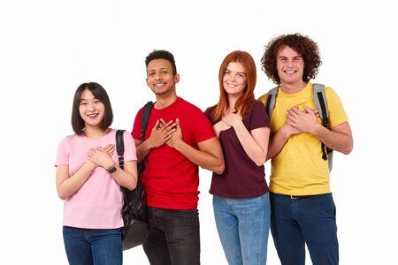 Photo pour Kind multiethnic people keeping hands near heart - image libre de droit