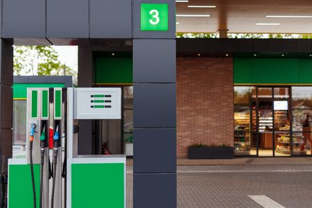 Photo for Gas pump near store on filling station - Royalty Free Image