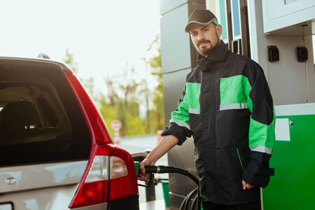 Photo pour Gas station worker looking at camera - image libre de droit