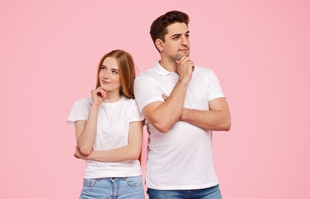Photo pour Man and woman rubbing chin and thinking looking away - image libre de droit