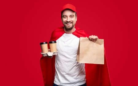 Photo for Cheerful male superhero delivering food - Royalty Free Image