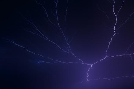 Lightning arcs in the night sky in dramatic fashion