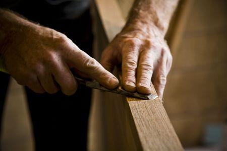 Photo pour Close-up of man doing carpentry. Horizontally framed shot. - image libre de droit