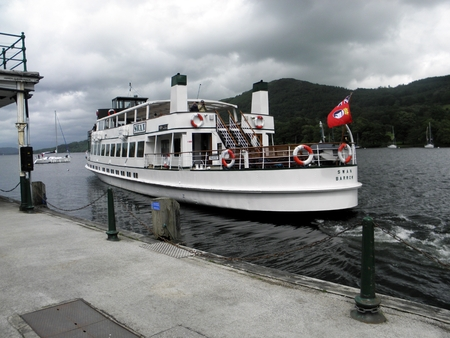 Lakeside,Cumbria,United Kingdom - June 29, 2012  The Windermere Steamer MV Swan  built 1938  leaving Lakeside dock Lake Windermere on its route to Bowness-on-Windermere before heading on to Waterhead on England s longest lake  10 5 miles