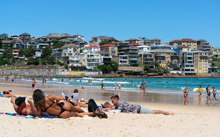 24th December 2018, Bondi Sydney Australia: Woman wearing thong or G-string bikini and Bondi beach panorama in Sydney Australia