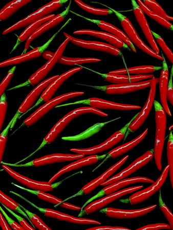 bunch of red hot chili peppers on black background