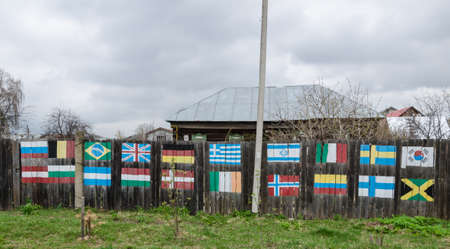 The flags painted on the old fence