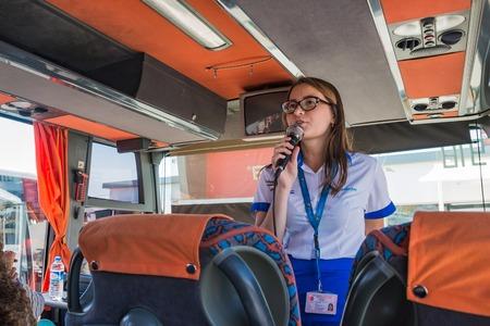 Foto de Side, Turkey - June, 22, 2017: Guide in a tourist bus in Turkey in Side - Imagen libre de derechos