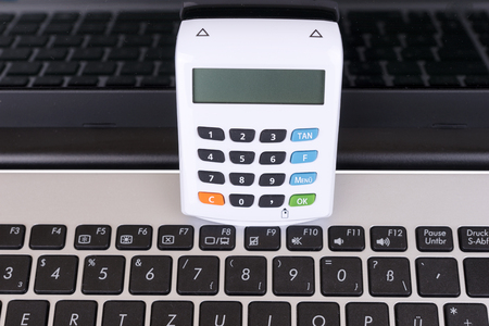 White optical chip TAN Generator and laptop for banking