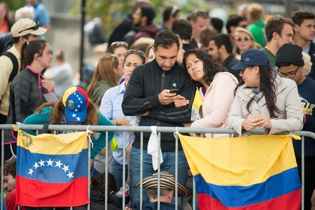 PHILADELPHIA, PA - SEPTEMBER 26: Crowds of people arrive on the Benjamin Franklin Parkway in Center City Philadelphia to see Pope Francis at the World Meeting of Families on September 26, 2015