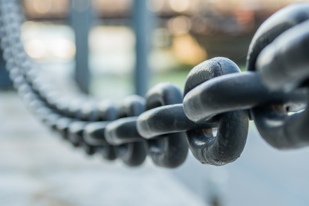 Large Iron Chain Fades out of Focus
