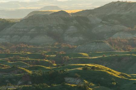 Photo for Evening Light Settles Across Theodore Roosevelt National Park in North Dakota - Royalty Free Image