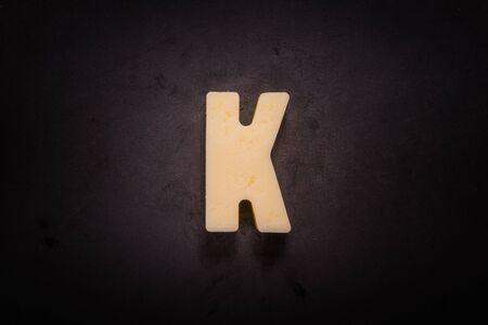 Foto de Butter Forms K on cast iron skillet background - Imagen libre de derechos