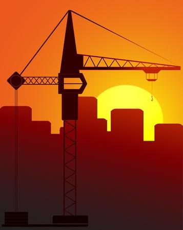 construction crane against the evening city