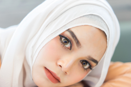 Fashion portrait  beautiful muslim woman with the white  hijab