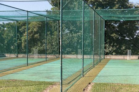 Photo pour A close up view of a grass practice cricket nets - image libre de droit