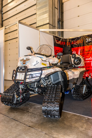 Winter 2015. Morning. Russia. Moscow. Crocus-Expo. Exhibition Motopark-2015 (BikePark-2015). The exhibition stand of the studio GL-Audio. The ATV on tracks.