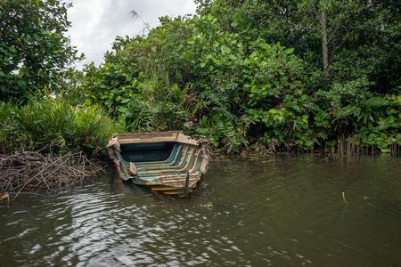 Sri Lanka. Bentota  . The vicinity of Bentota. Bentota River. Broken boat on the shore of the river.