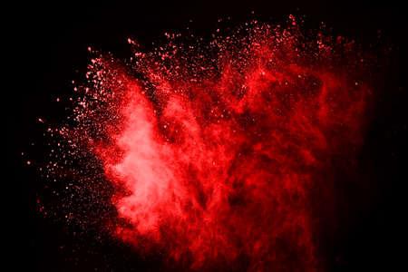 Foto de abstract red powder explosion on black background.abstract red powder splatted on black background. Freeze motion of red powder exploding. - Imagen libre de derechos